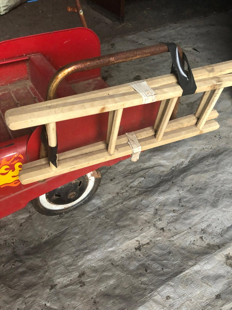 Vintage Fire Engine Toy Pedal Car with Ladders In Distressed Condition For Sale In Hopewell, NJ