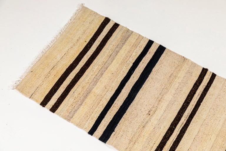 Vintage flat-weave Konyan cream black and brown striped runner.