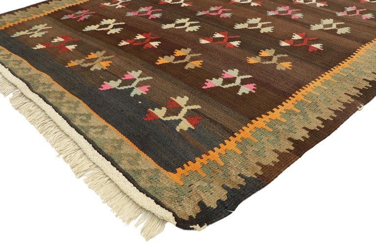70293, vintage flat-weave Turkish Floral Kilim rug with boho farmhouse style. Bright and versatile, this handwoven wool vintage Turkish floral Kilim rug beautifully embodies a boho farmhouse style. The abrashed dark brown abrashed field features an