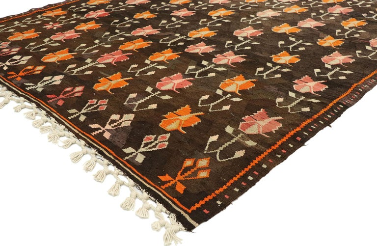 70298 vintage flat-weave Turkish Floral Kilim rug with boho farmhouse style. Bright and versatile, this handwoven wool vintage Turkish floral kilim rug beautifully embodies a boho farmhouse style. The abrashed dark brown abrashed field features an
