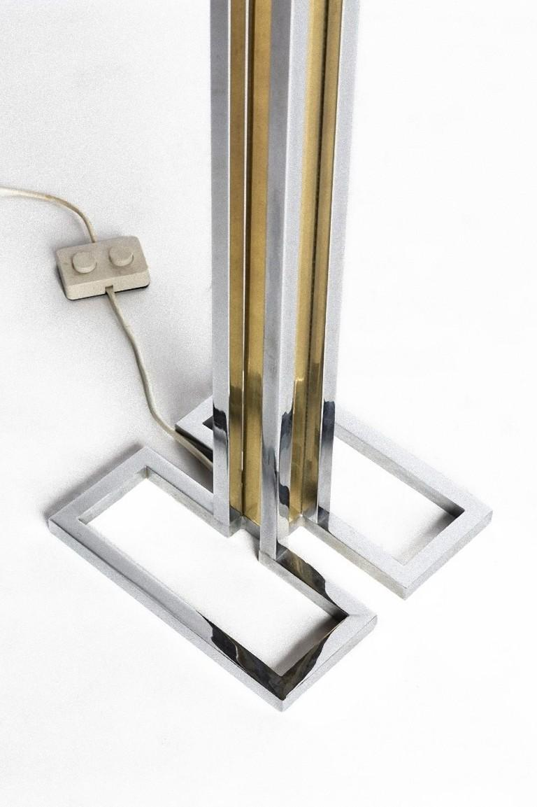 This vintage floor lamp is a decorative object realized very likely by Romeo Rega circa 1970s.