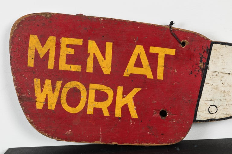 Double sided Men At Work pointing hand. Thick wood and hand painted. Great American Folk Art trade sign in the form of a pointing hand. Two drilled holes that must have been for hanging at some point. Large iron bolts go through the top. Loss to top