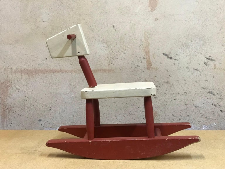 Very cool vintage mid-century children's rocking horse, handmade, circa 1955 with a Bauhaus aesthetic.  Well constructed, old paint, well functioning, very sculptural and usable as a toy.