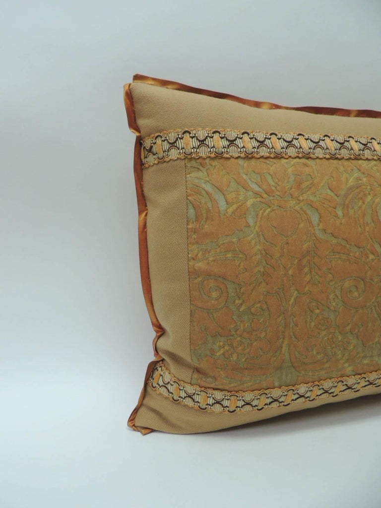"""Vintage Fortuny """"Medici"""" orange on silver decorative bolster pillow, Framed with camel color cashmere and embellished with French woven orange and brown trim. ATG custom flat trim in orange silk same as backing. Decorative pillow handcrafted and"""