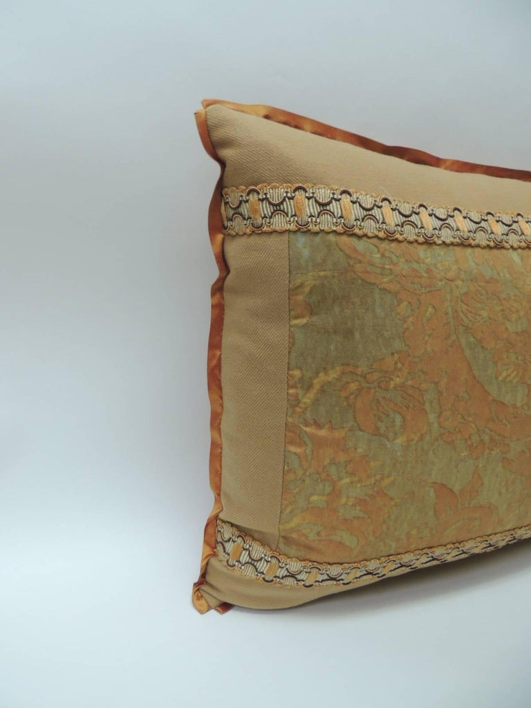 "Vintage Fortuny ""Medici"" orange on silver decorative bolster pillow, framed with camel color cashmere and embellished with French woven orange and brown trim. ATG custom flat trim in orange silk same as backing. Decorative pillow handcrafted and"