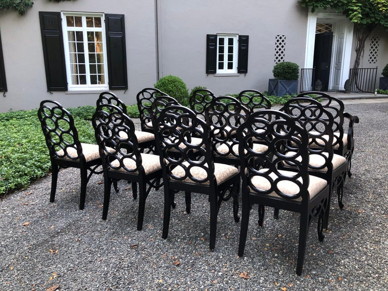 This is a rare set of twelve iconic Francis Elkins Loop chairs in a black satin matte lacquer. The seats with newer Fortuny fabric. The looped backs sit atop upholstered slip seats; chairs have a cabriole leg and an openwork skirt. Original