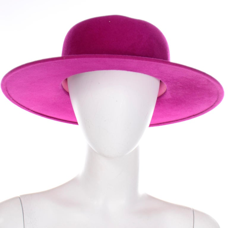 This pretty vintage magenta pink felted wool hat was designed by Frank Olive and has the I Magnin store label. This beautiful hat is so beautifully made and we love hats that have a nice brim! This would be a great hat to wear to any Spring event