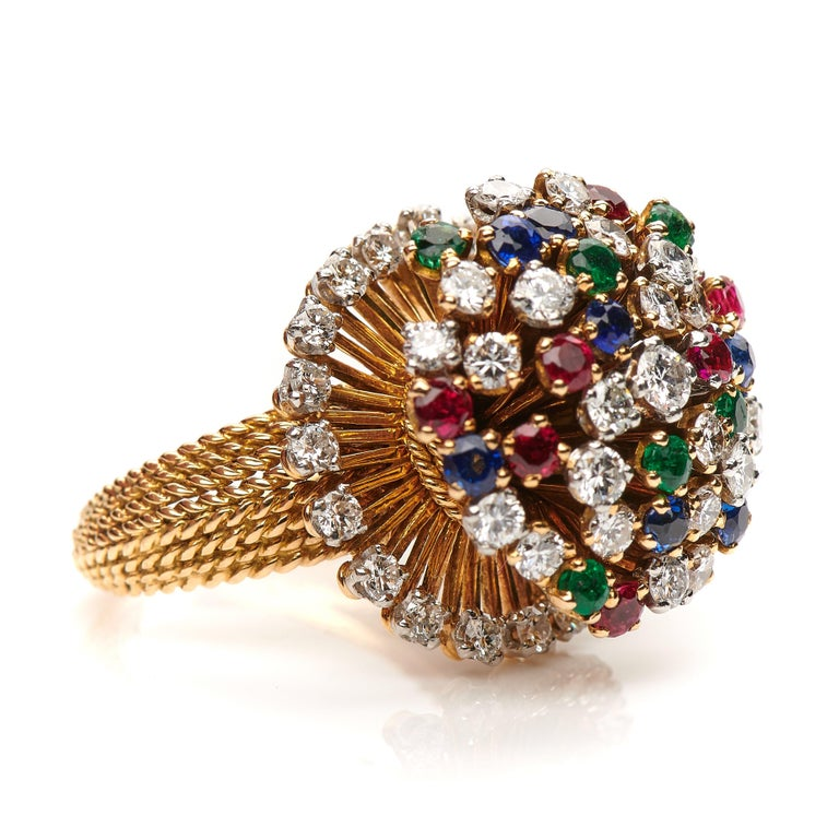 Retro, French, 18ct yellow gold, multi gem; sapphire, emerald and diamond cluster ring, circa 1950. This is a truly fabulous ring, set with an array of precious stones creating a wonderful explosion of colour. The incredible craftsmanship of the