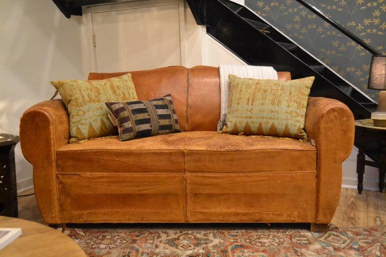 This stunning leather sofa bed originated in France, circa 1930s.
