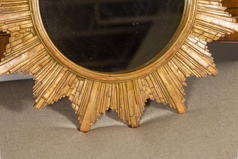 20th Century Vintage French 1970s Gilt Composition Sunburst Mirror with Rays of Varying Sizes For Sale