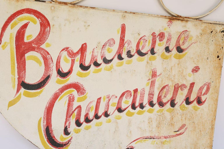 This is a hand painted Boucherie Charcuterie French sign. It once hung in a French butcher shop. French to English translation: Boucherie - Butchery; Charcuterie - Delicatessen. This piece is perfect for a kitchen or restaurant.