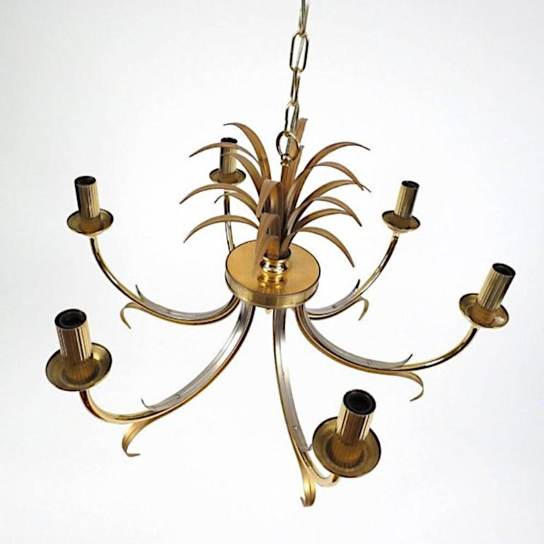 Beautiful brass and steel chandelier in the Maison Jansen fashion. Timless and simple, the perfect touch of elegance.