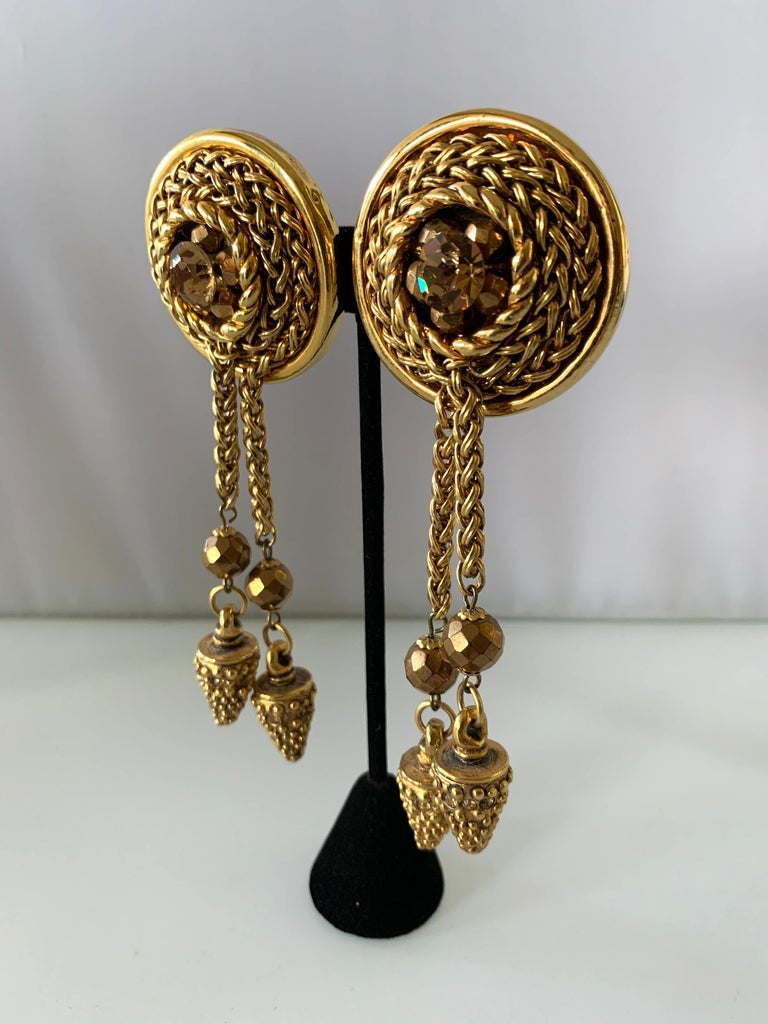 Vintage oversized bronze double tassel statement clip-on earrings by Claire Deve Paris - circa 1980 accented by large bronze glass faceted rhinestones and beads.