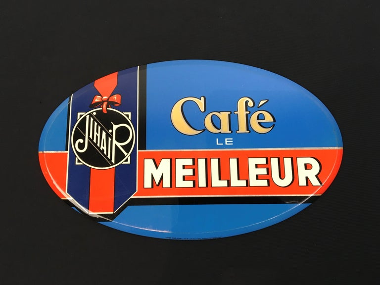 Vintage coffee sign for the French coffee brand Jihair Coffee.  Jihair coffee is the best coffee - Le meilleur café.  It's a bright blue oval sign with a red band and a kind of ribbon with the Jihair logo on.  Under signed: Usines Rob. Otten