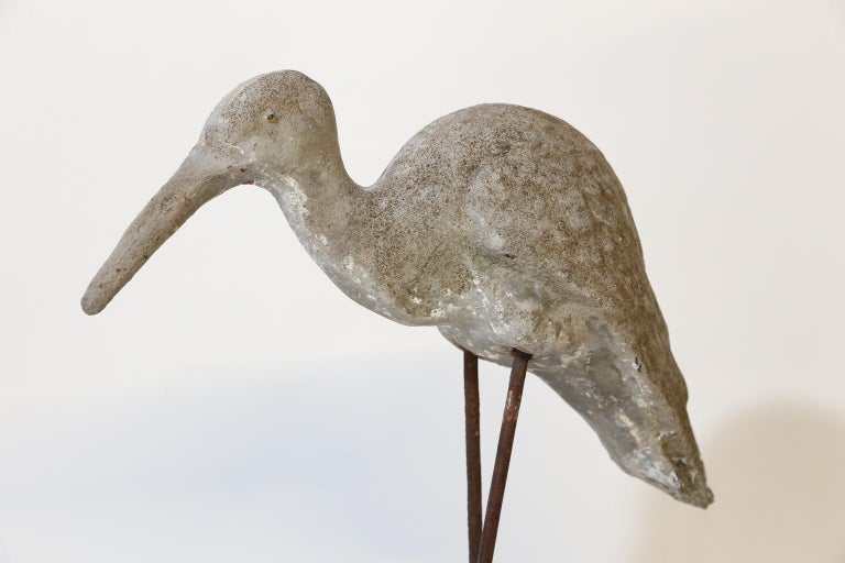This concrete shore bird sits on iron legs and a concrete base. Found in southern France this piece will add a bit of whimsy to your home or garden.