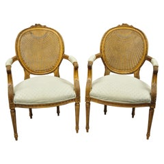 Vintage French Country Louis XVI Oval Cane Back Fauteuil Lounge Chairs, a Pair