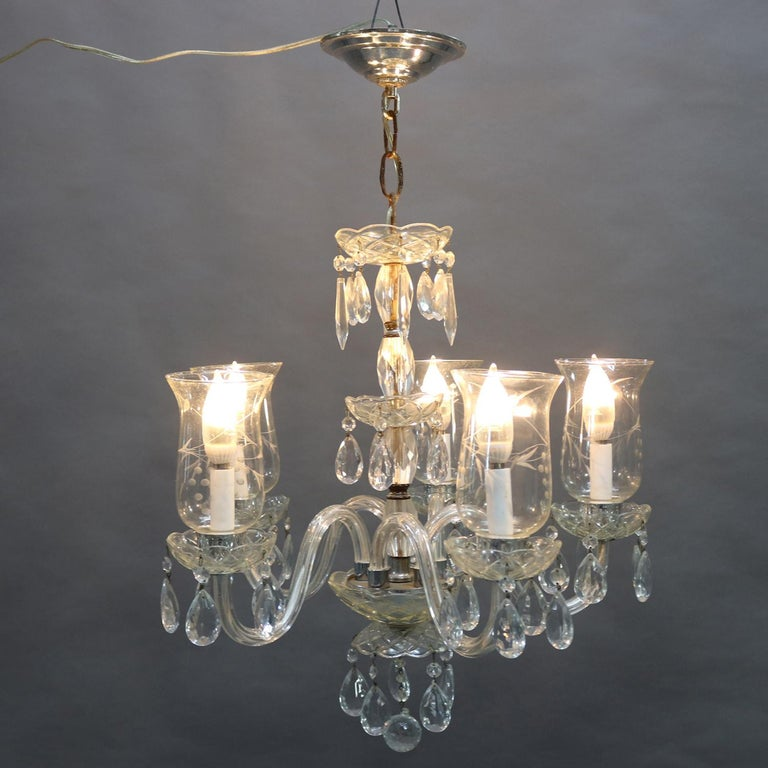 Vintage French chandelier features chrome frame with central crystal column having five s-scroll glass arms terminating in candle lights with cut-glass shades, rock and strung crystal highlights throughout, circa 1940.  ***DELIVERY NOTICE – Due to