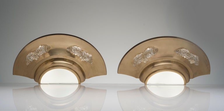 Original pair of brass and glass deco wall sconces from France. Fantastic design with glass details and two bulbs per sconce. Frosted glass to bottom allowing for light to travel down. Sconces have been rewired.