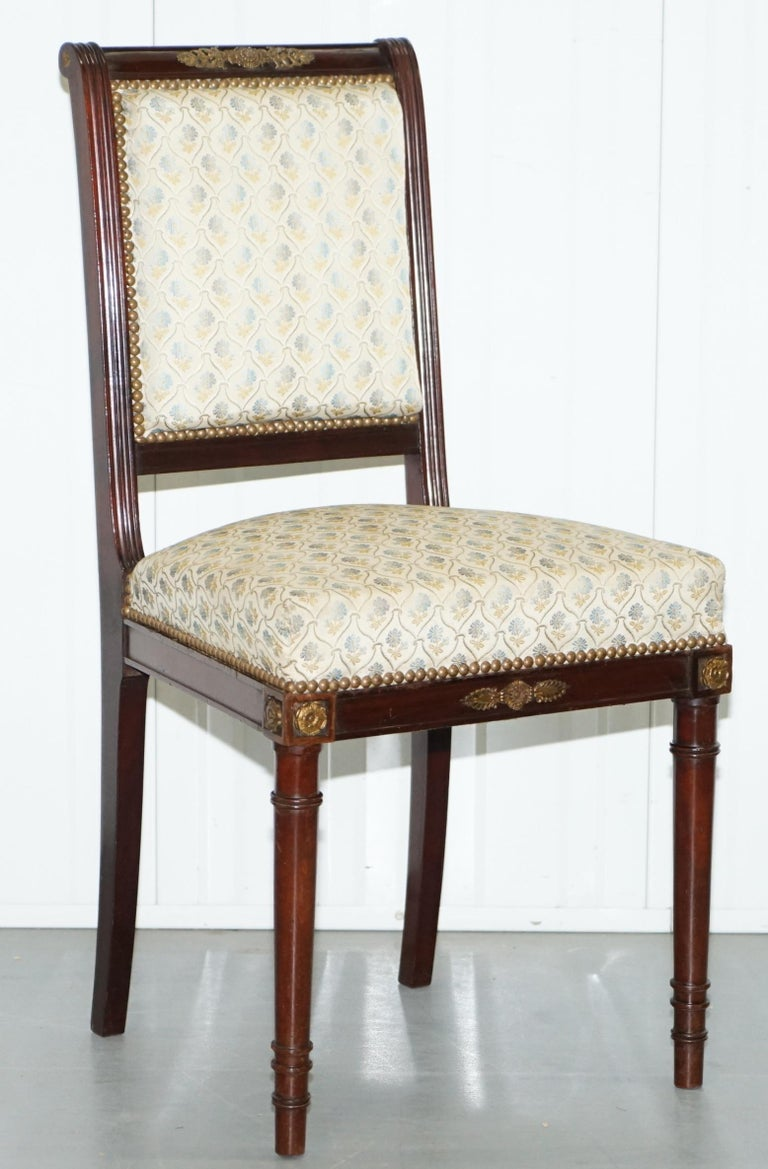 We are delighted to offer for sale this pair of vintage French Empire style Napoleon chairs with Ormolu mounts.