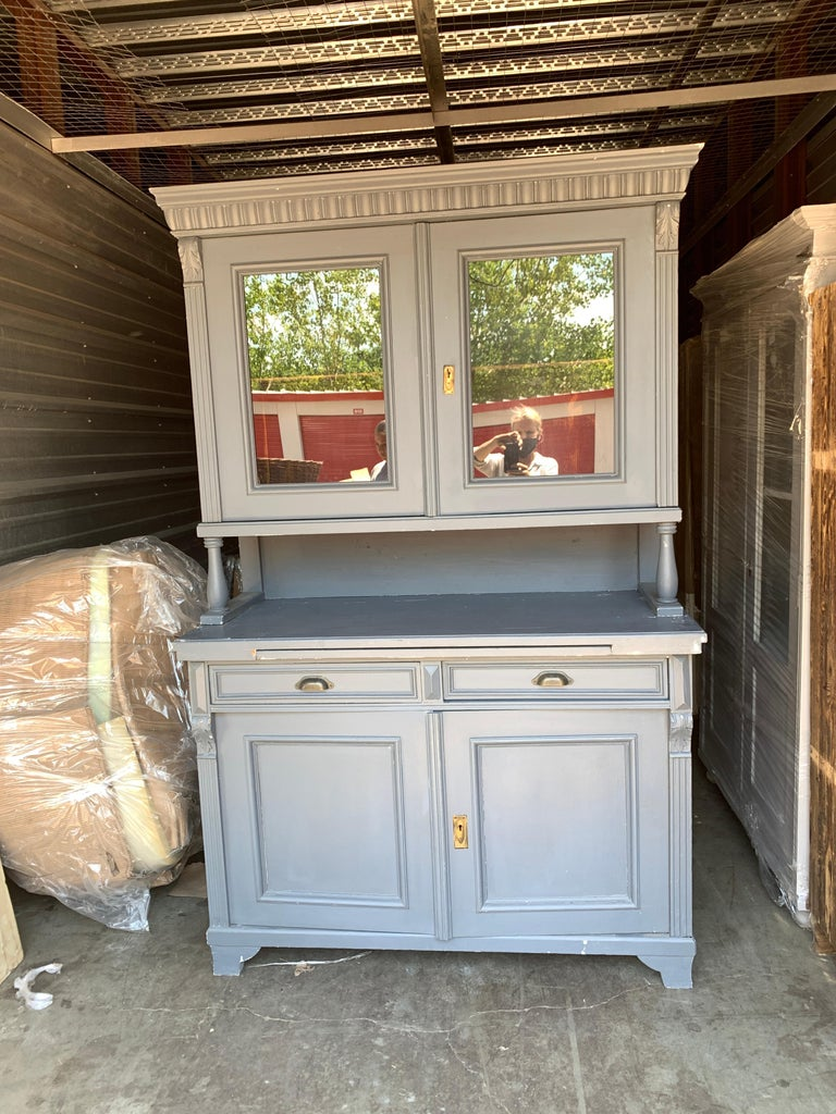 A welcoming French farmhouse hutch in modern powdered blue color. Perfect for a home that loves to live with their furniture and utilize a piece to its full potential.