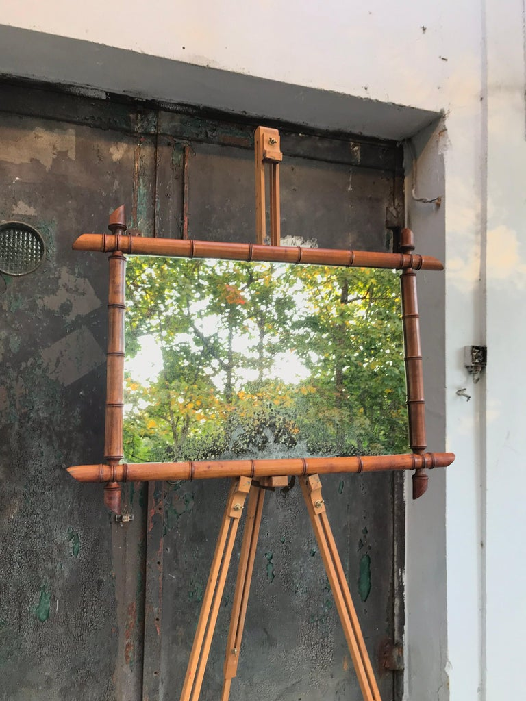 Vintage French faux bamboo mirror of a very good quality Made from turned fruitwood Very attractive patina to the glass plate and also the faux bamboo frame So much more than just a mirror Also a piece of stunning wall art.