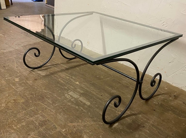 French coffee table with glade top and wrought Iron base. This coffee table can be used indoors or outdoors. Great simple and elegant style makes it easy to use in almost any decor.