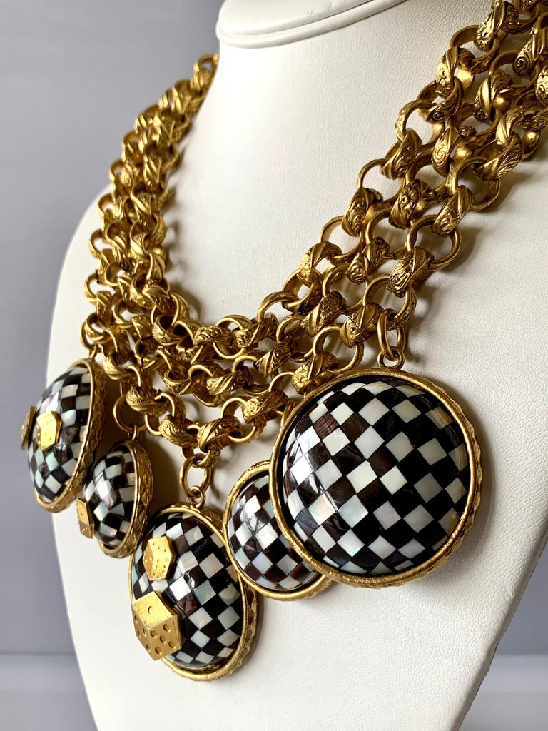 Vintage Mercedes Robirosa chunky three-dimensional gold-tone statement necklace featuring large round checkered mother of pearl charms embellished by gold dice - made in France.   Note: The necklace has a wearable length of up to 18 inches.