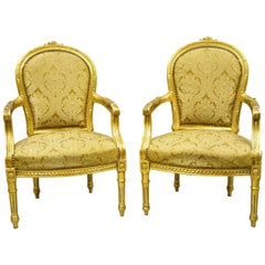 Vintage French Louis XVI Gold Leaf Balloon Back Fauteuil Armchairs, a Pair