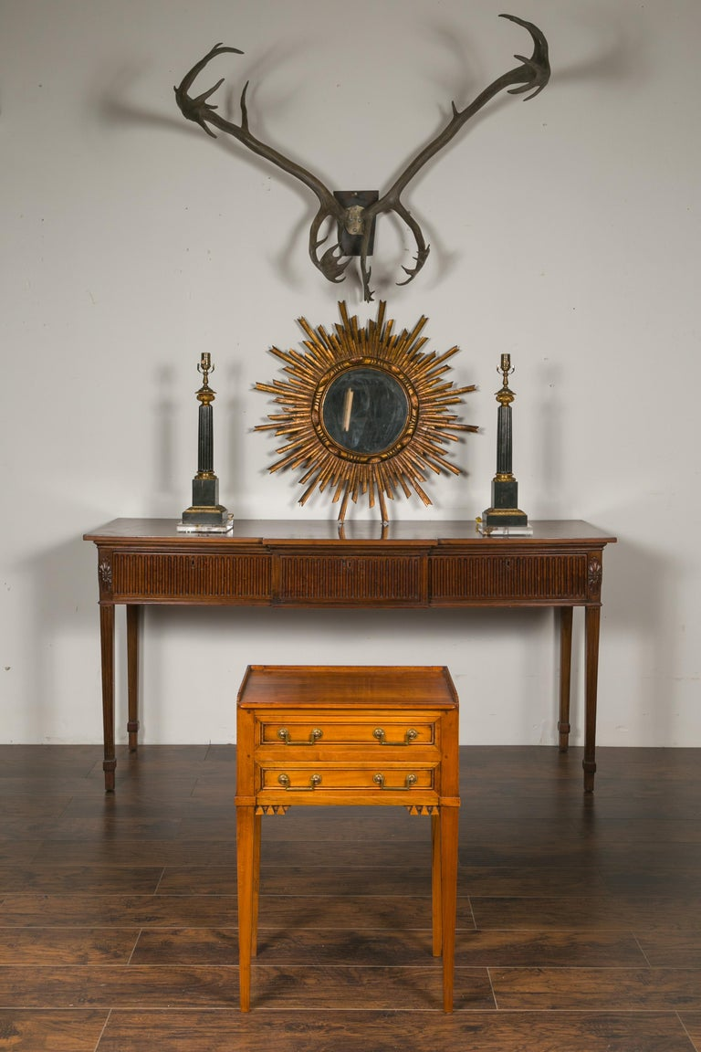 A vintage French neoclassical style walnut bedside table from the mid-20th century, with three-quarter gallery, two drawers and carved motifs. Created in France during the mid-century period, this walnut side table features a rectangular top