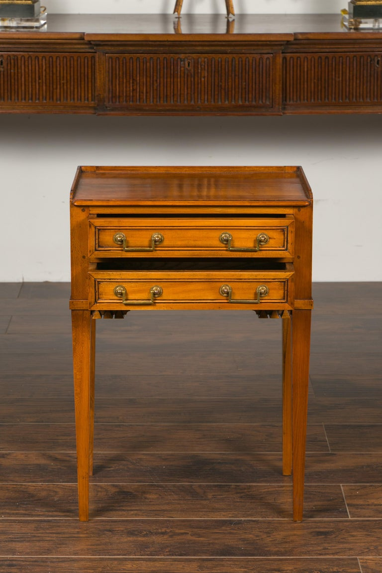 20th Century Vintage French Neoclassical Style Walnut Side Table with Carved Pyramidal Motifs For Sale