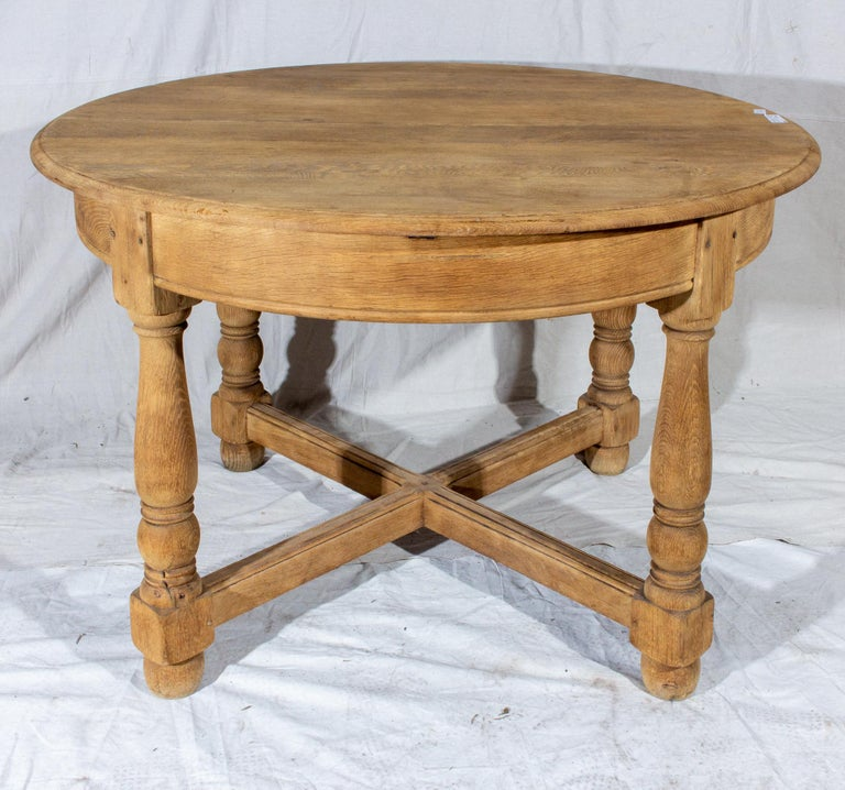 This vintage, French oak butterfly leaf table is perfect for those who need a little extra room for special gatherings. When closed, this table easily accommodates four people comfortably... and when guests arrive, simply open the middle section and