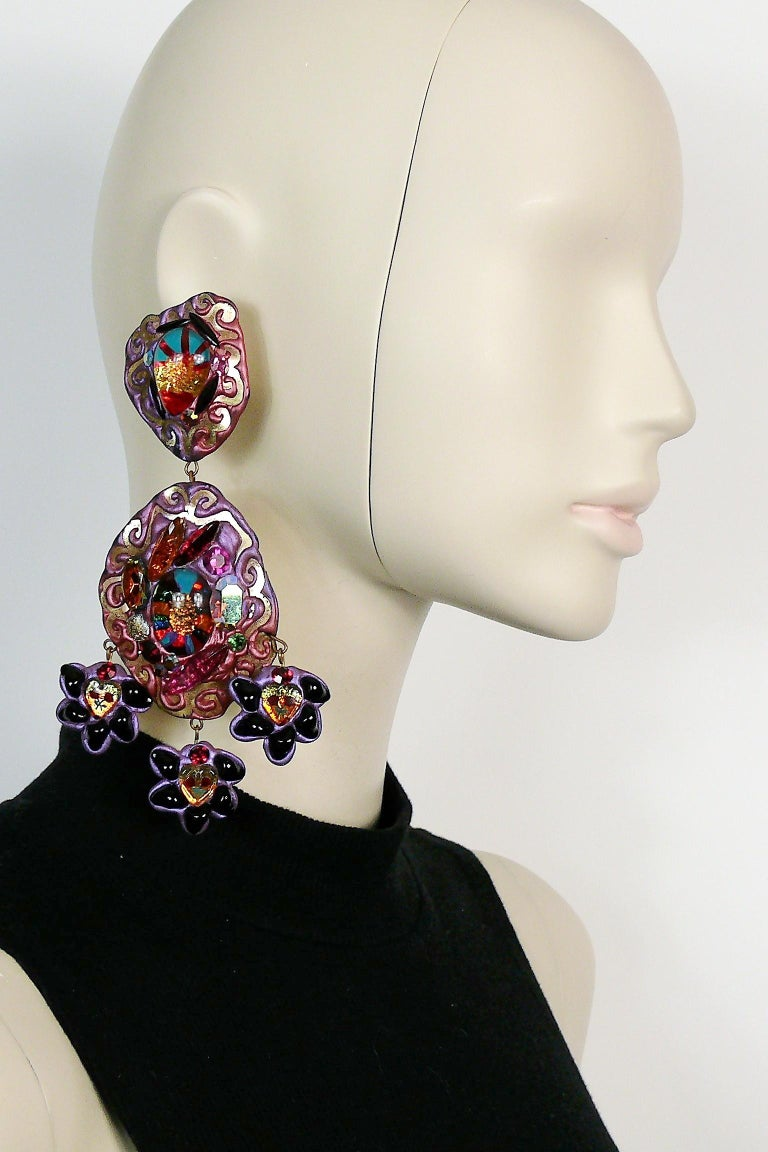One-of-a-kind vintage French oversized dangling earrings.  These earrings are made of a light weight malleable material (probably rubber or latex) embellished with glass beads, crystals  and a gold tone embossed design.  The ex-owner has confirmed