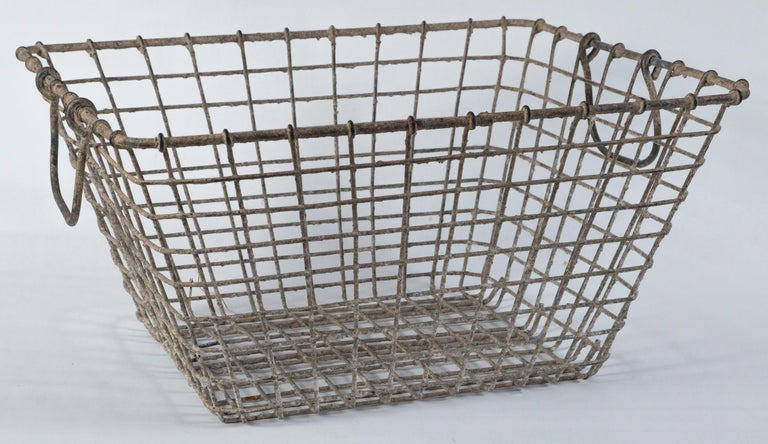 Vintage French oyster baskets - Set of two, 20th century. Used by French oyster farmers at low tide for harvest. Aged patina.