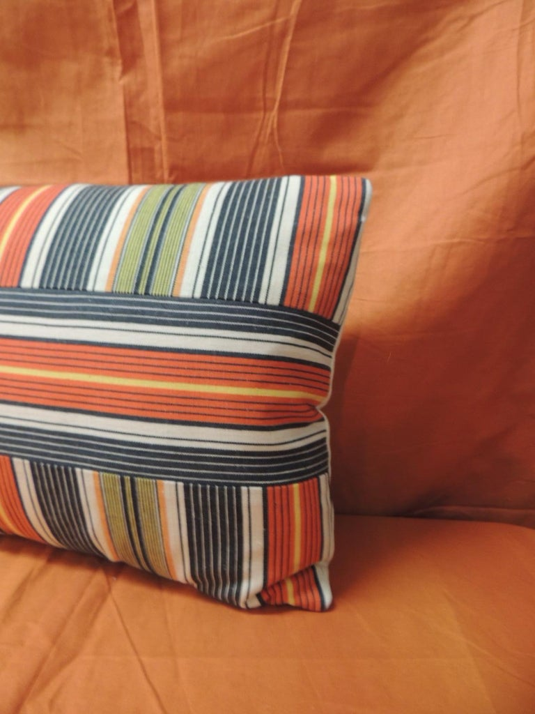 Vintage French provincial linen multi-color stripes decorative lumbar pillow Decorative lumbar pillow handmade with a with vintage French provincial linen with multi-color custom designed stripes to create a more modern layout. In shades of orange,