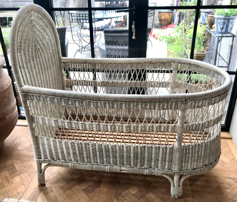 French wicker baby bed/ crib. Safe to use for a baby since there are no large spaces, but as with all cribs a bumper pad should be used (standard size will fit) 