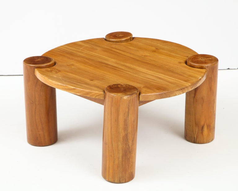 Vintage wood table with cylindrical legs, France, circa 1950s. In the style of Charlotte Perriand.