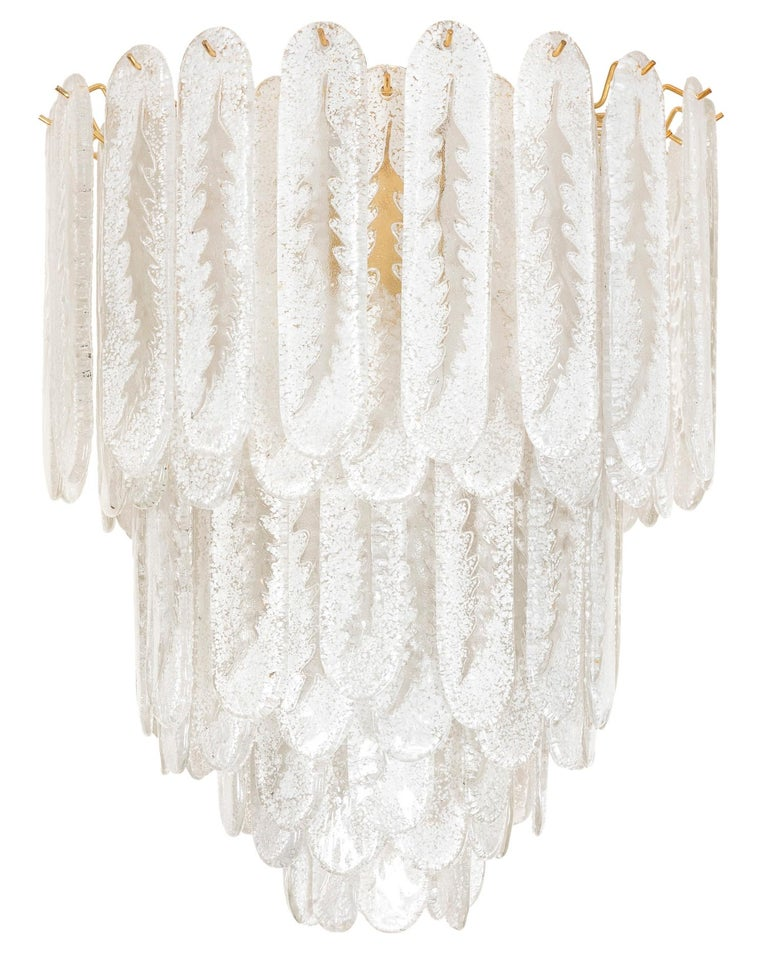 This dazzling multi layered Murano light is adorned with rounded rectangular frosted glass surrounding a brass interior frame. It is wired for North America.