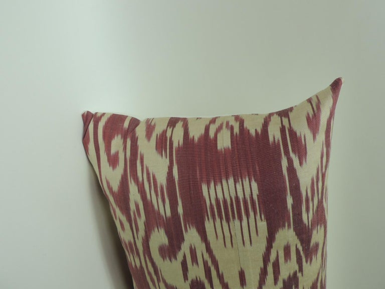 """Vintage fuchsia and natural silk Ikat bolster decorative pillows depicting stylized flowers and paisleys. The colors of the flowers, in the front of the decorative pillow, white stripe silk.  """"Ikat, or Ikkat, is a dyeing technique used to pattern"""
