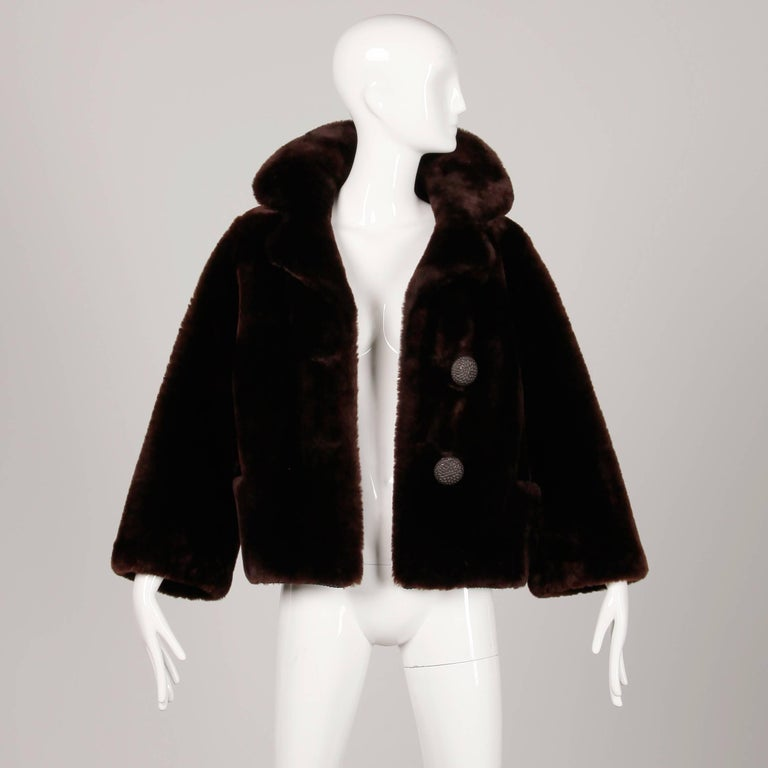 Stunning vintage 1960s genuine mouton fur jacket in perfect condition. So heavy and warm! Fully lined with front button closure. Hidden pockets. Fits like a modern size large. The bust measures 40