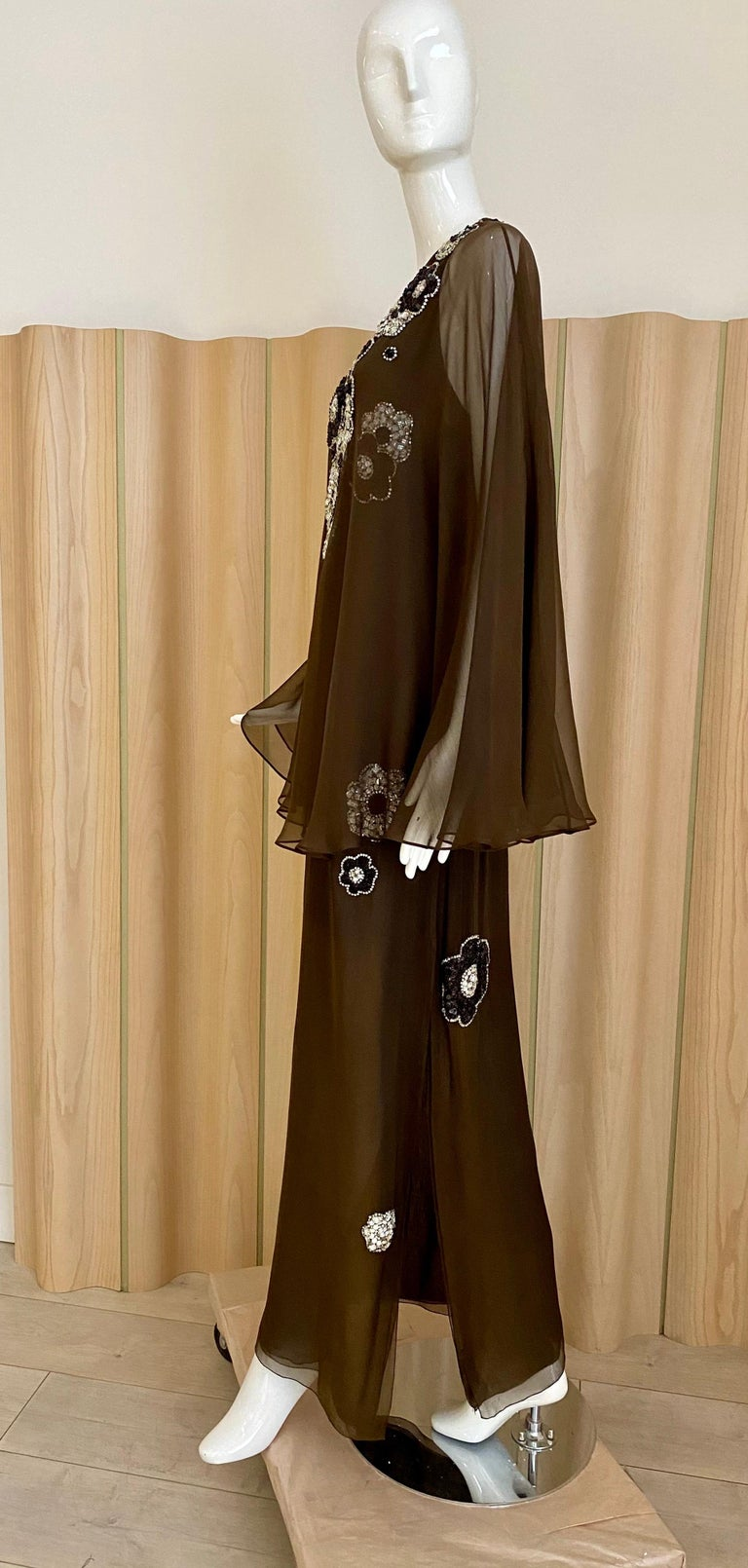 """1970s Galanos Brown Silk Gown with beaded embroidery. Bust: 34/ Waist: 27"""" / hip : 34"""" Size: 4/ small *** See stains and small tiny pin holes on left shoulder and distressed on neckline"""