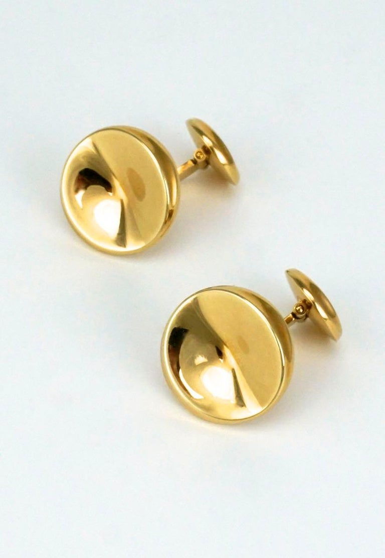 A pair of 18k yellow gold concave disc cufflinks with an arched toggle back fitting.  Jensen cufflinks in gold are rare to find and these, with their clean modernist design, would easily take you from the office to the opera - marked with post 1945