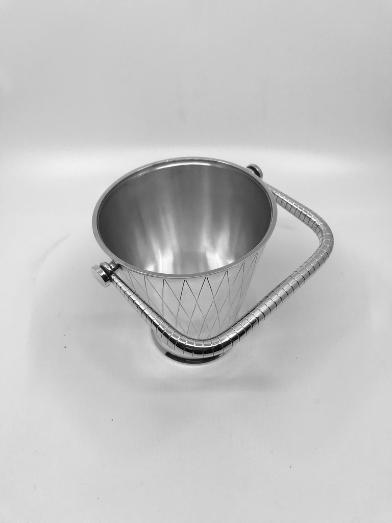 This is a sterling silver Georg Jensen ice pail, design #819D by Sigvard Bernadotte from 1938, part of the cocktail set with the same design number #819.  The actual pail measures 5 1/8? in height, diameter at top 4 5/8? (13cm, 11.7cm). Total