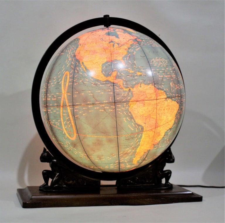 American Vintage George F. Cram Co. Figural Brass Atlas Illuminated Terrestrial Globe For Sale