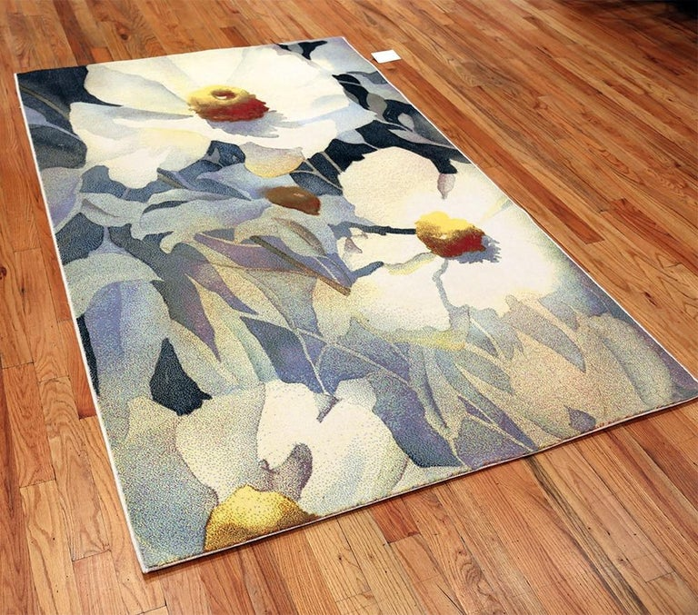 Vintage Scandinavian art rug designed by renowned American artist Georgia O'Keeffe, country of origin / rug type: Vintage Scandinavian rugs, date: circa Mid-20th century. The beautiful floral design on this mid-20th century vintage Scandinavian rug
