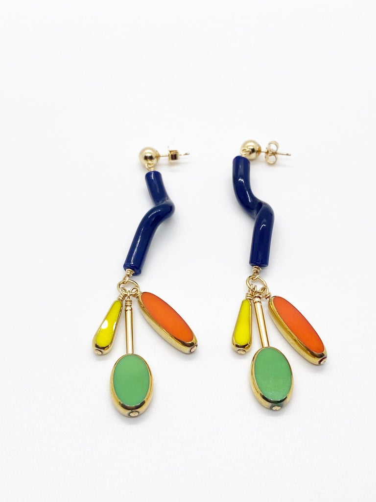 These are such fun earrings. These earrings will sure be a conversation starter. It consist of vintage noodle glass beads with 3 bright vintage glass beads that are edge with 24K gold and finished with 14K gold filled stud.  The vintage German beads