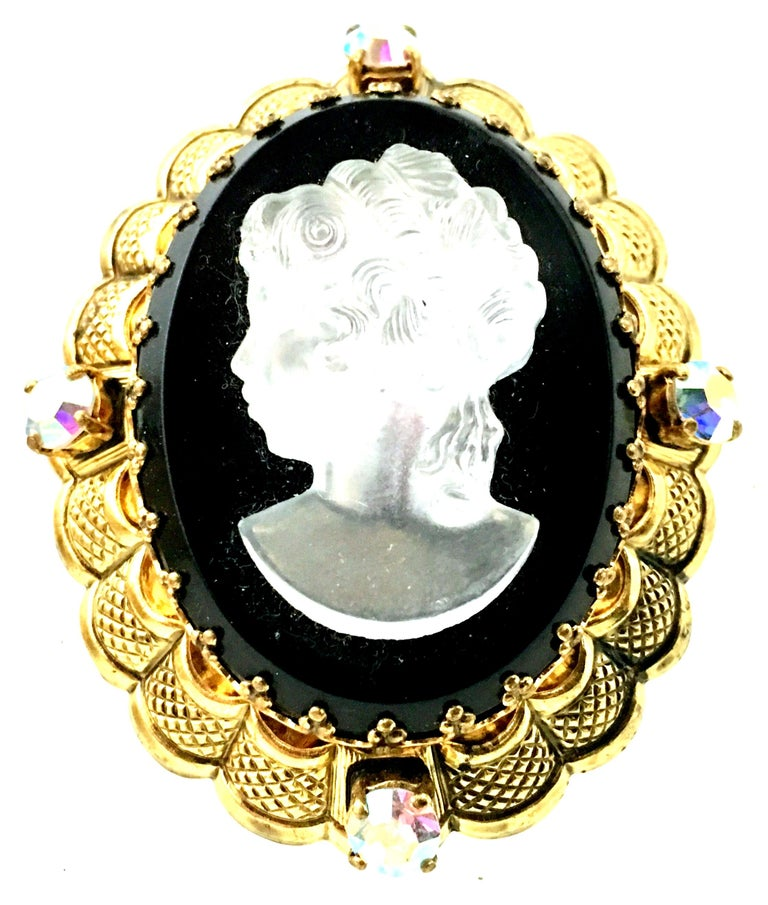 Mid-20th Century Gold Plate Filigree Prong Set Polished & Faceted Carved Glass Cameo Brooch. This mother of pearl carved glass right facing girl cameo sits a top a black faceted glass mount for the incredible dimensional effect. Surrounded by four