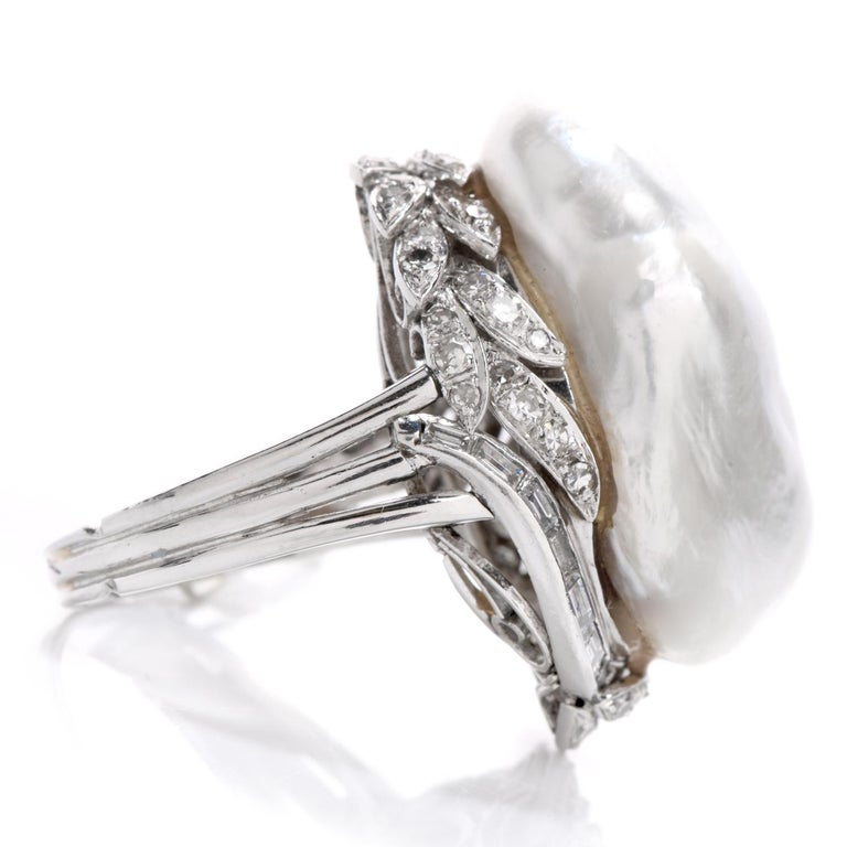 Wear this memorable ethereal Diamond & Baroque Pearl Platinum ring at your next formal occasion.   This whimsical ring boasts one large spectacular 26 mm x 17 mm white saltwater pearl.   Forty-Eight round cut, and 15 baguette cut genuine diamonds,
