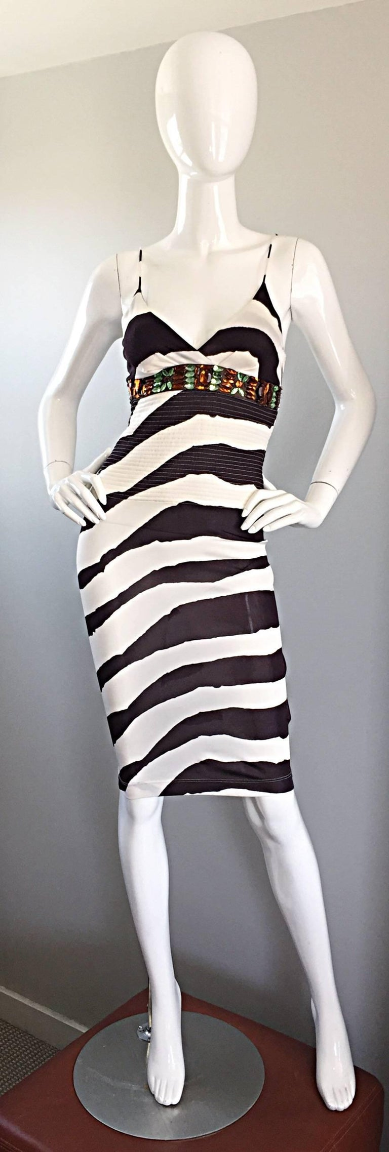 Amazing vintage GIANFRANCO FERRE (early 90s) brown and white abstract zebra printed rayon jersey BodyCon dress! Features incredible Amber and green crystal jewels below bust. Intricate stitching below bust. Hidden zipper up the side with