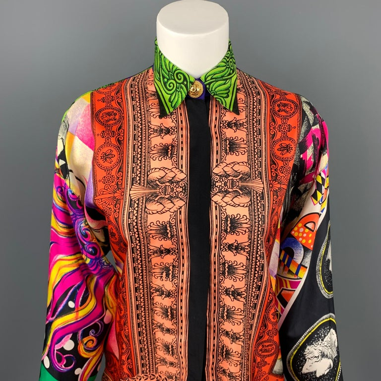 Vintage GIANNI VERSACE blouse comes in a multi-color baroque silk featuring gold button details, spread collar, and a hidden button closure. Minor discoloration. Made in Italy.  Very Good Pre-Owned Condition. Marked: IT 38  Measurements:  Shoulder: