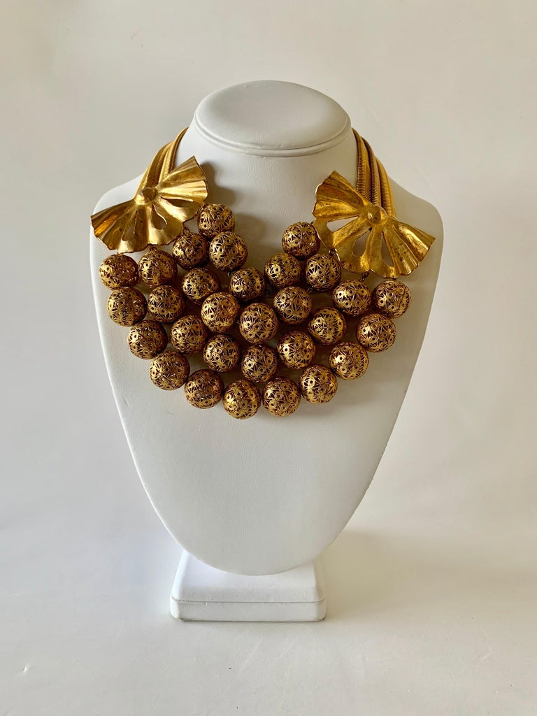 Scarce vintage gilt, Rochas Paris statement necklace circa the 1940s-1950s. This special necklace was designed by Max Boinet and executed by Mr. Robert Goossens for Rochas, comprised out of gilt metal the statement necklace features romantic yet